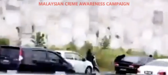 Viral Video showing motorist being robbed in Malaysia