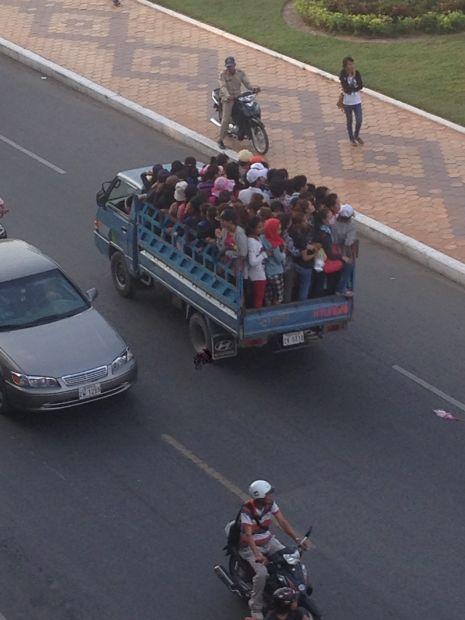 Phnom Penh Trucks with People