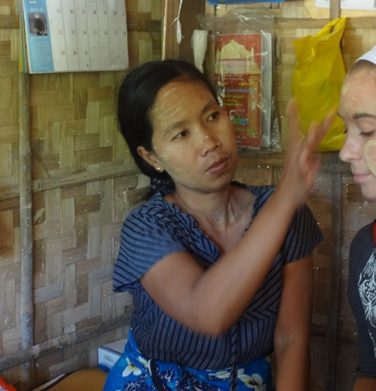 7_6.A tourist getting thanaka applied to her face_cropped